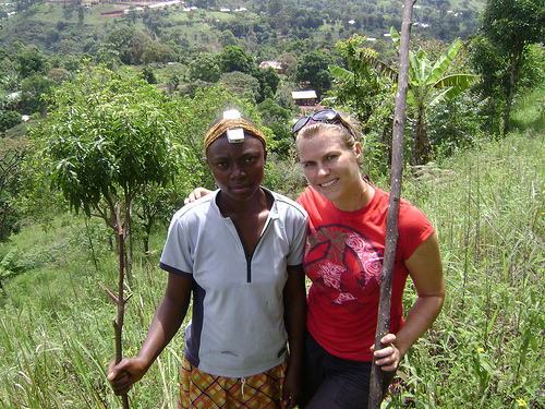 Hiking in the village with Regine. (That's a cell phone on her head.)
