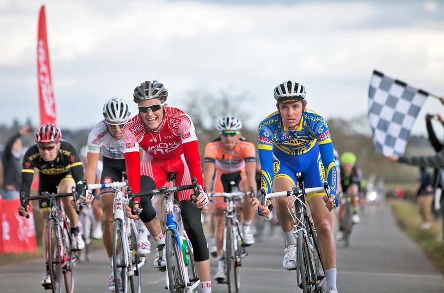 Image: crossing finish line on bike