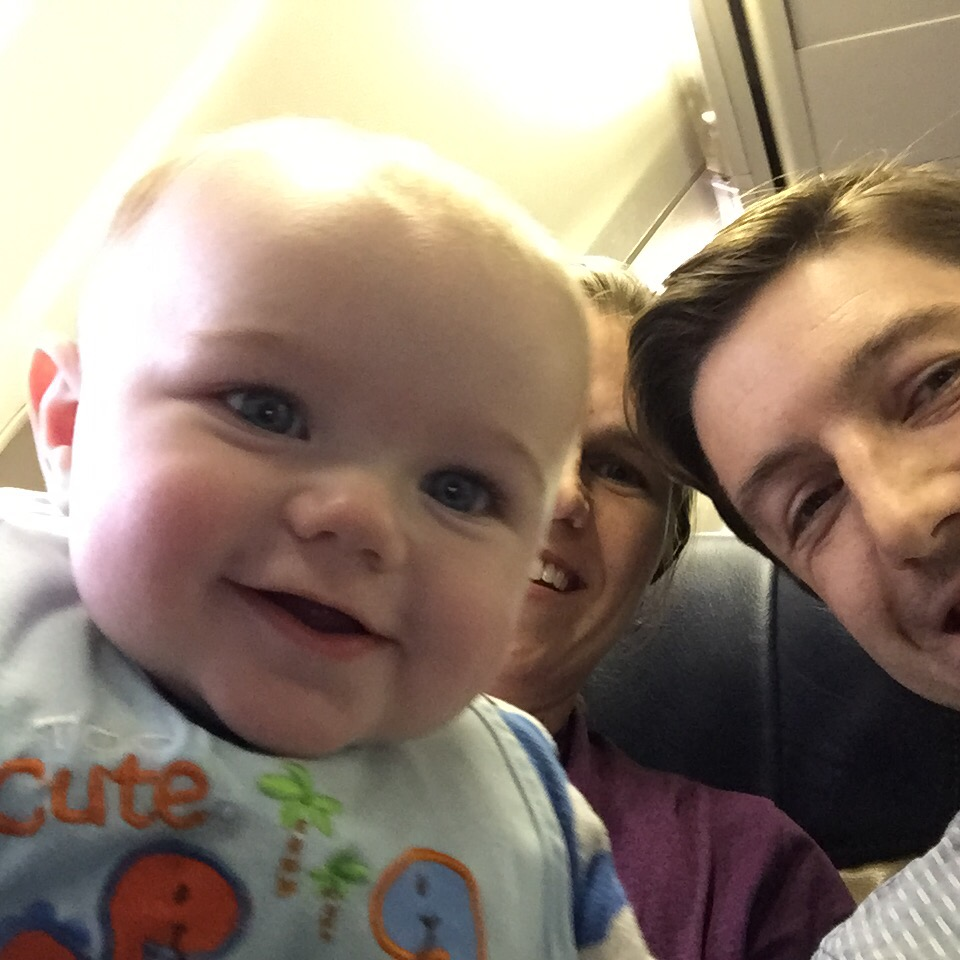 Family selfie during a plane ride when D was six months old.