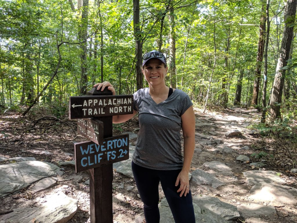 Standing in front of an Appalachian Trail sign